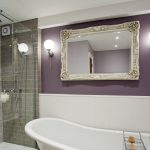 Image: Bathroom with corner shower and freestanding bath