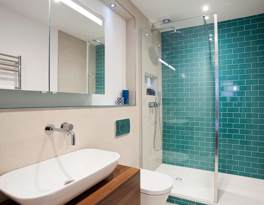 Image: Ensuite with large shower featuring monceau teal crackle tiles