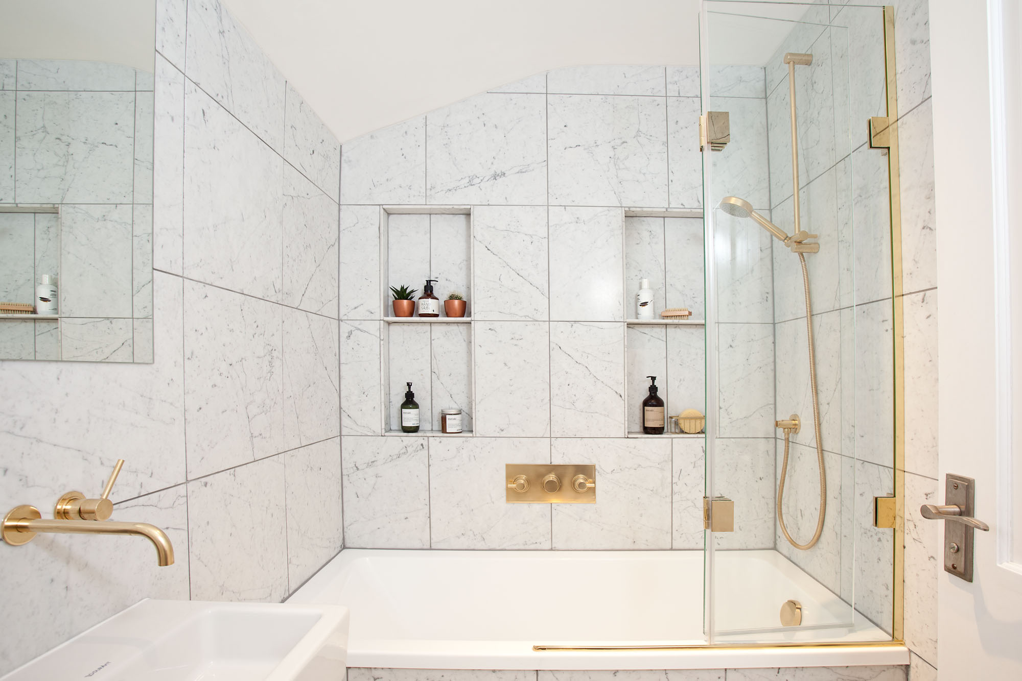 Carrara Marble Family Bathroom With Gold Finishes