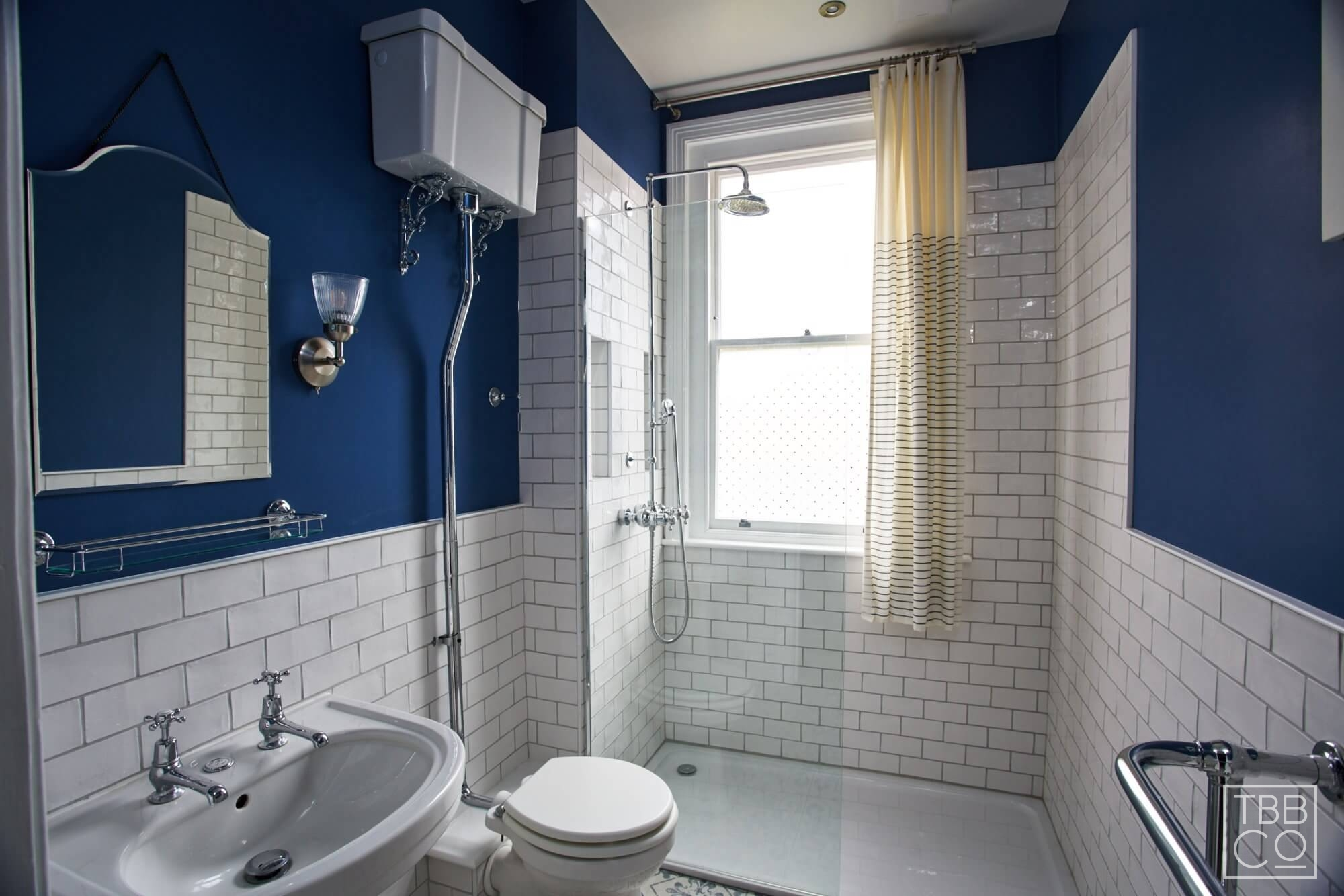 second bathroom in period property with blue accents and